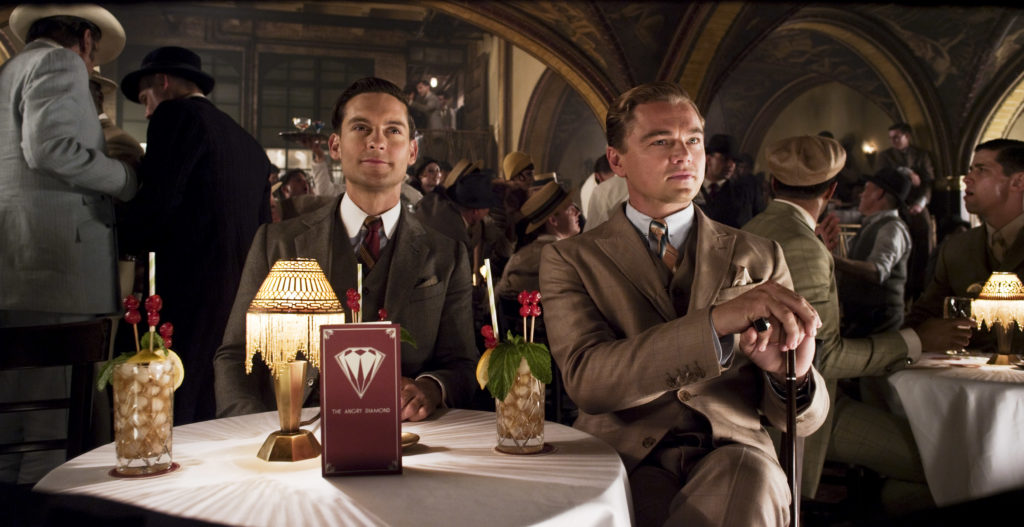 """(L-r) TOBEY MAGUIRE as Nick Carraway and LEONARDO DICAPRIO as Jay Gatsby in Warner Bros. Pictures' and Village Roadshow Pictures' drama """"THE GREAT GATSBY,"""" a Warner Bros. Pictures release."""